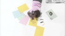 【動画素材】寝っ転がって絵を描く少女